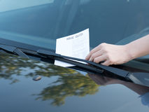 Parking violation ticket fine on windshield Royalty Free Stock Photography