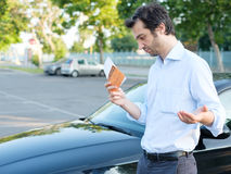 Parking violation ticket fine on windshield Stock Photos