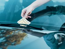 Parking violation ticket fine on windshield Royalty Free Stock Photos