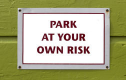 Parking Warning Sign on Ugly Green Wall Royalty Free Stock Photos