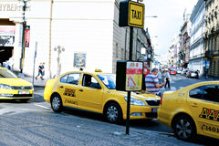 Parking of yellow taxi cars in Prague Royalty Free Stock Image