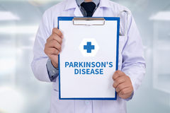 PARKINSON'S DISEASE. Portrait of a doctor writing a prescription Royalty Free Stock Image