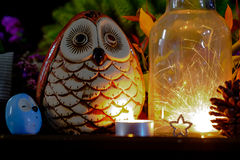 Parklers in Glass jar at night with Owl doll. Concept of sparklers in Glass jar at night with Owl doll Royalty Free Stock Images