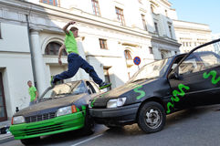 Parkour jump. Parkour acrobat jumping over the cars at the street of Warsaw, Poland on September 17, 2011 Stock Image