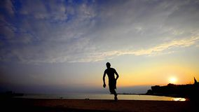 Parkour, Sunset silhouette teen boy flips in sky, slow motion stock video