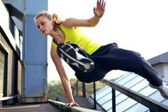Free Parkour Technique Vaulting Railing Stock Photo - 23380920