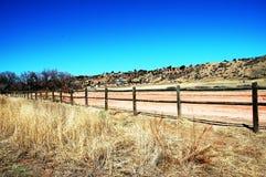 Parkowa droga z ogrodzeniem Fotografia Stock