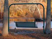 Parkowa huśtawka w jesieni Obraz Royalty Free