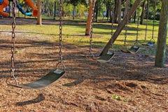 Parkowi huśtawek siedzenia Zdjęcia Royalty Free
