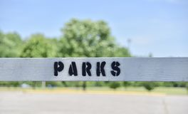 Parks and Recreation Division. A parks and recreation division upkeeps and maintains playground areas where adults and children can go to enjoy the outdoors in royalty free stock photo