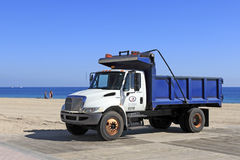 Parks and Recreation Dump Truck. FORT LAUDERDALE, FLORIDA - JANUARY 28, 2014: Parked on a wooden platform just north of Fort Lauderdale Beach Park a white and Royalty Free Stock Photography