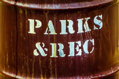 Parks and Recreation. Interesting photo of 'parks & rec' spray painted on a garbage can Royalty Free Stock Photos