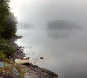 Parkside Bay Canoe. A canoe sitting on the granite shoreline of Parksid bay in Algonquin Provincial Park, in Ontario, Canada Royalty Free Stock Photo