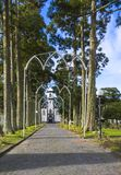 Parkway with small white and gray church of Sao Nicolau at the village of Sete Cidades on the island of Sao Miguel. Azores, Portugal royalty free stock photo