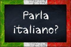 Parla-italiano Tafel mit Italien-Flaggenrahmen lizenzfreie stockbilder