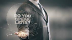 Parlate le nuove tecnologie disponibile di Holding dell'uomo d'affari latino royalty illustrazione gratis