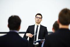 Parler à la conférence Images stock