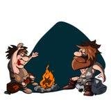Parler de deux hommes des cavernes Photo libre de droits