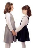 Parler de deux petites filles.   Photo stock