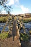 Parley Gorge Wooden Bridge, Derbyshire Peak District. The old wooden footbridge in Padley Gorge, Derbyshire, Peak District Stock Images