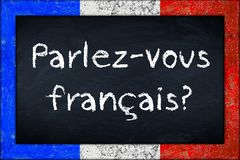 Parlez-vous francais blackboard with franceh flag frame Royalty Free Stock Image