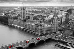 Parliament. Black and White Aerial view of the Houses of Parliament with selective colour red london Buses Royalty Free Stock Photos