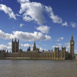 Parliament. View from the South bank of river Thames at Westminster Palace and Tower Clock, London, UK royalty free stock image