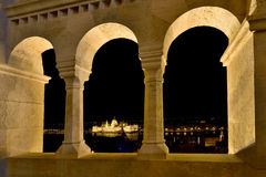 Parliament through the arch of Fishermen's Bastion in Budapest,. Hungary, Europe Stock Photos