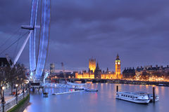 Parliament, Big Ben and the London Eye at dusk Stock Photo