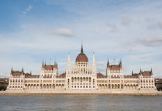 Parliament in Budapest. Hungarian parliament with clouds and river Royalty Free Stock Photos