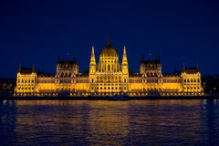 The Parliament of Budapest at Night. A nighttime photo of The Hungarian Parliament Building, also known as the Parliament of Budapest.  It is one of Europe's Stock Photos
