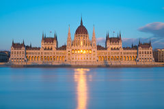 Parliament building in Budapest, Hungary on a sunset. With reflection of setting Sun in front windows Royalty Free Stock Photography