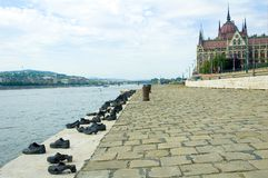 Parliament Building in budapest and shoes. Shoes on the shore of the danube by budapest parliament building Royalty Free Stock Photography