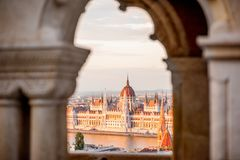 Parliament building in Budapest. View through the arch on the famous Parliament building during the sunset in Budapest, Hungary Royalty Free Stock Image