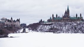Parliament Building on Canada stands tall on Parliament Hill on a grey gloomy day. royalty free stock images