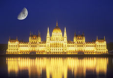 Parliament building and Moon. Parliament building at night. Budapest, capital of Hungary Royalty Free Stock Photo