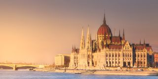 Parliament building and river Danube of Budapest. View of hungarian Parliament building and river Danube during sunset in Budapest, Hungary Stock Photo