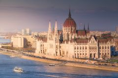 Parliament building and river Danube of Budapest. View of hungarian Parliament building and river Danube during sunset in Budapest, Hungary Royalty Free Stock Images