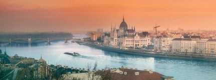 Parliament building and river Danube of Budapest. View of hungarian Parliament building and river Danube during sunset in Budapest, Hungary royalty free stock photo