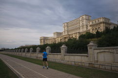 Parliament building with a runner, Bucharest, Romania Royalty Free Stock Image