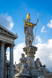 Parliament building in Vienna, Austria and statue of Pallas Athena Brunnen Royalty Free Stock Photography