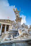 Parliament building in Vienna, Austria and statue of Pallas Athena Brunnen Royalty Free Stock Image