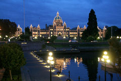 Parliament buildings at night, piers, Victoria, Canada. The Parliament buildings lit up in the background shines like ten thousands lights when strolling along Stock Photography