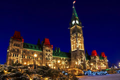 Parliament Buildings in Ottawa, Canada at Christmastime. Parliament Buildings in Ottawa, Canada's capitol, lit up with Christmas lights Royalty Free Stock Image