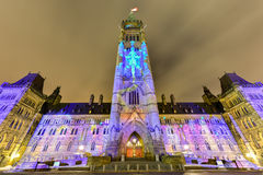 Parliament of Canada. Winter holiday light show projected at night on the Canadian House of Parliament to celebrate the 150th Anniversary of Confederation of Stock Image