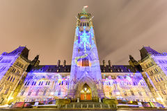 Parliament of Canada. Winter holiday light show projected at night on the Canadian House of Parliament to celebrate the 150th Anniversary of Confederation of Royalty Free Stock Photos