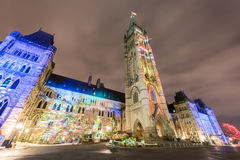 Parliament of Canada. Winter holiday light show projected at night on the Canadian House of Parliament to celebrate the 150th Anniversary of Canada in Ottawa Royalty Free Stock Photos