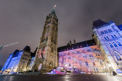 Parliament of Canada. Winter holiday light show projected at night on the Canadian House of Parliament to celebrate the 150th Anniversary of Canada in Ottawa Royalty Free Stock Photography