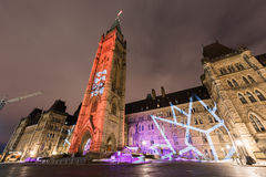 Parliament of Canada. Winter holiday light show projected at night on the Canadian House of Parliament to celebrate the 150th Anniversary of Canada in Ottawa Stock Photography
