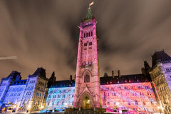 Parliament of Canada. Winter holiday light show projected at night on the Canadian House of Parliament to celebrate the 150th Anniversary of Canada in Ottawa Stock Image